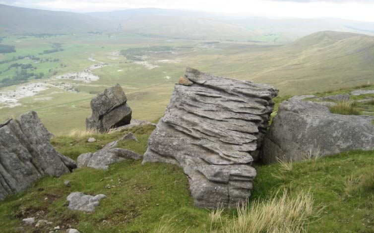 Weather worn gritstone on Ingleborough's summit. Stephen Oldfield