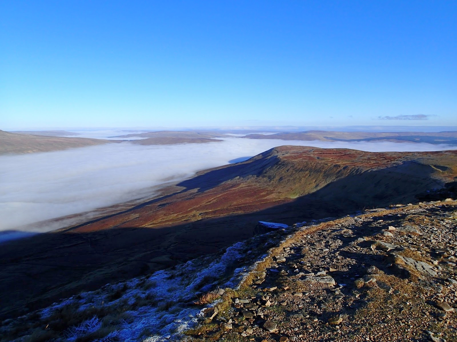 Cloud filling Chapel-le-Dale as seen from Ingleborough gives some idea of how a melting glacier may have appeared 16,000 years ago during the last glaciation. John Cordingley