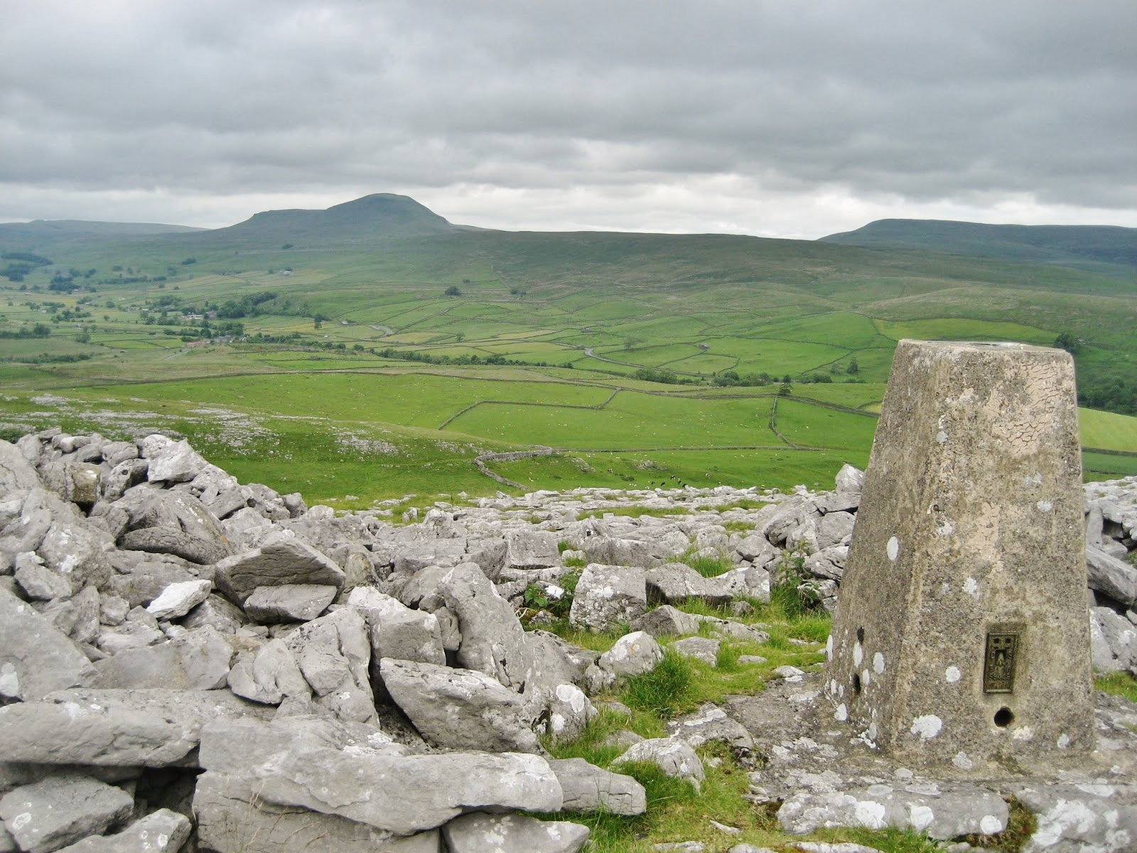 View of Ribblesdale from the summit of Smearsett Scar to the west.  The main ice flow moved from left to right across the picture.  The limestone benches beneath Pen-y-ghent have been smothered by a layer of drift, while a layer of alluvium covers the valley floor. Stephen Oldfield