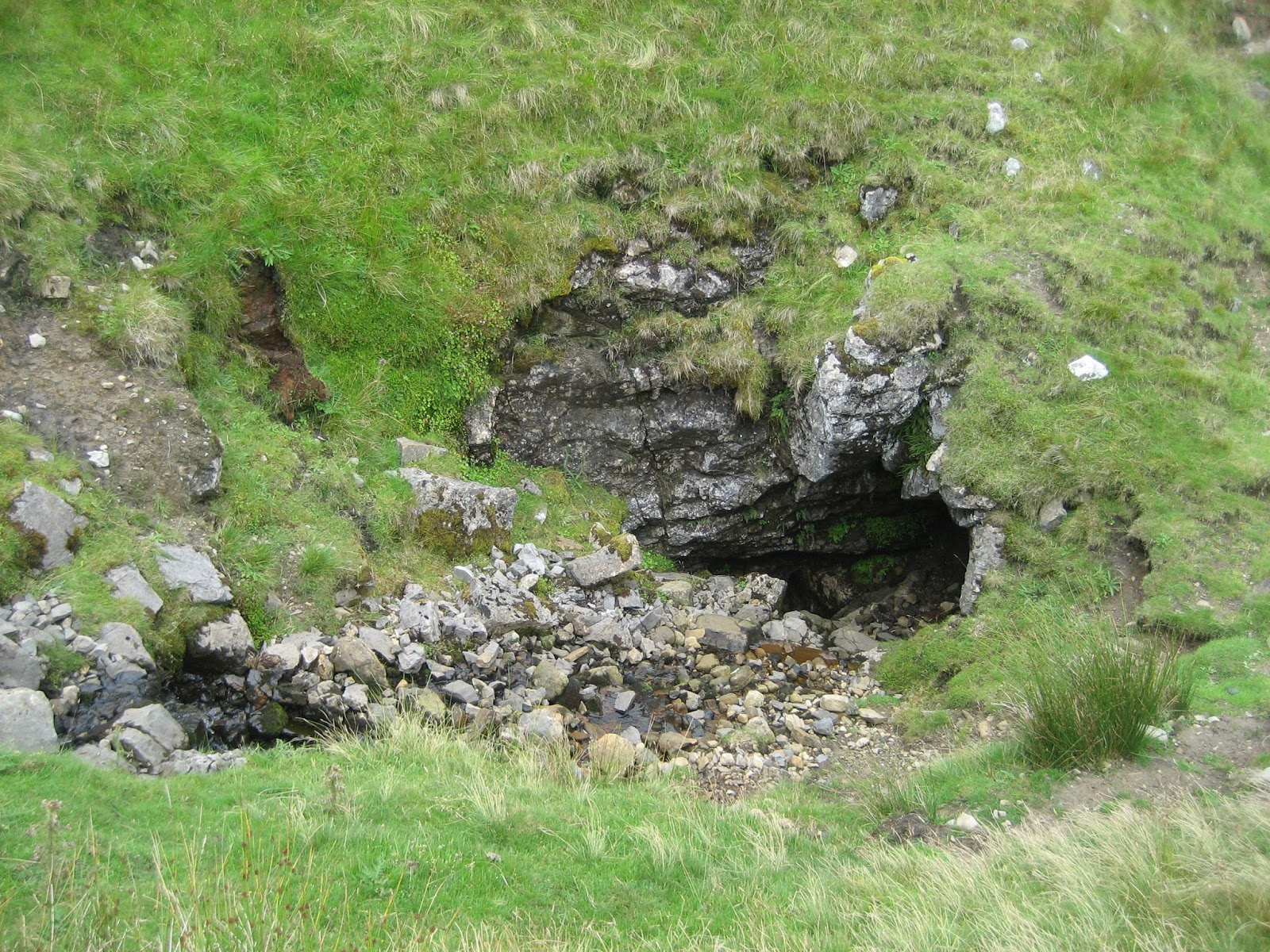 Tatham Wife Hole, where, thanks to the Green Edge Fault, water rushes out of the Hardraw Scar Limestone on the left, before disappearing into the Great Scar on the right. Stephen Oldfield