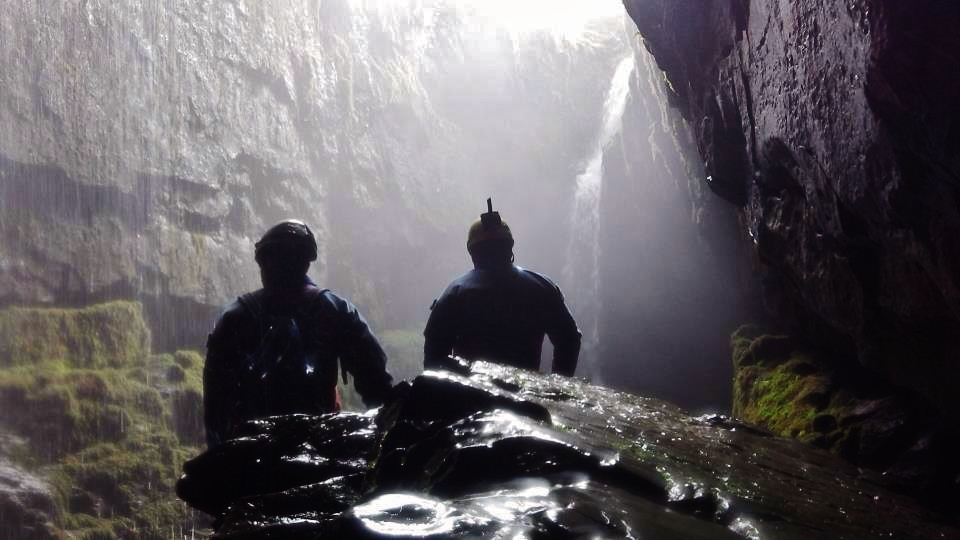 Emerging into the daylight shaft with the waterfall beyond. Paul Whittaker