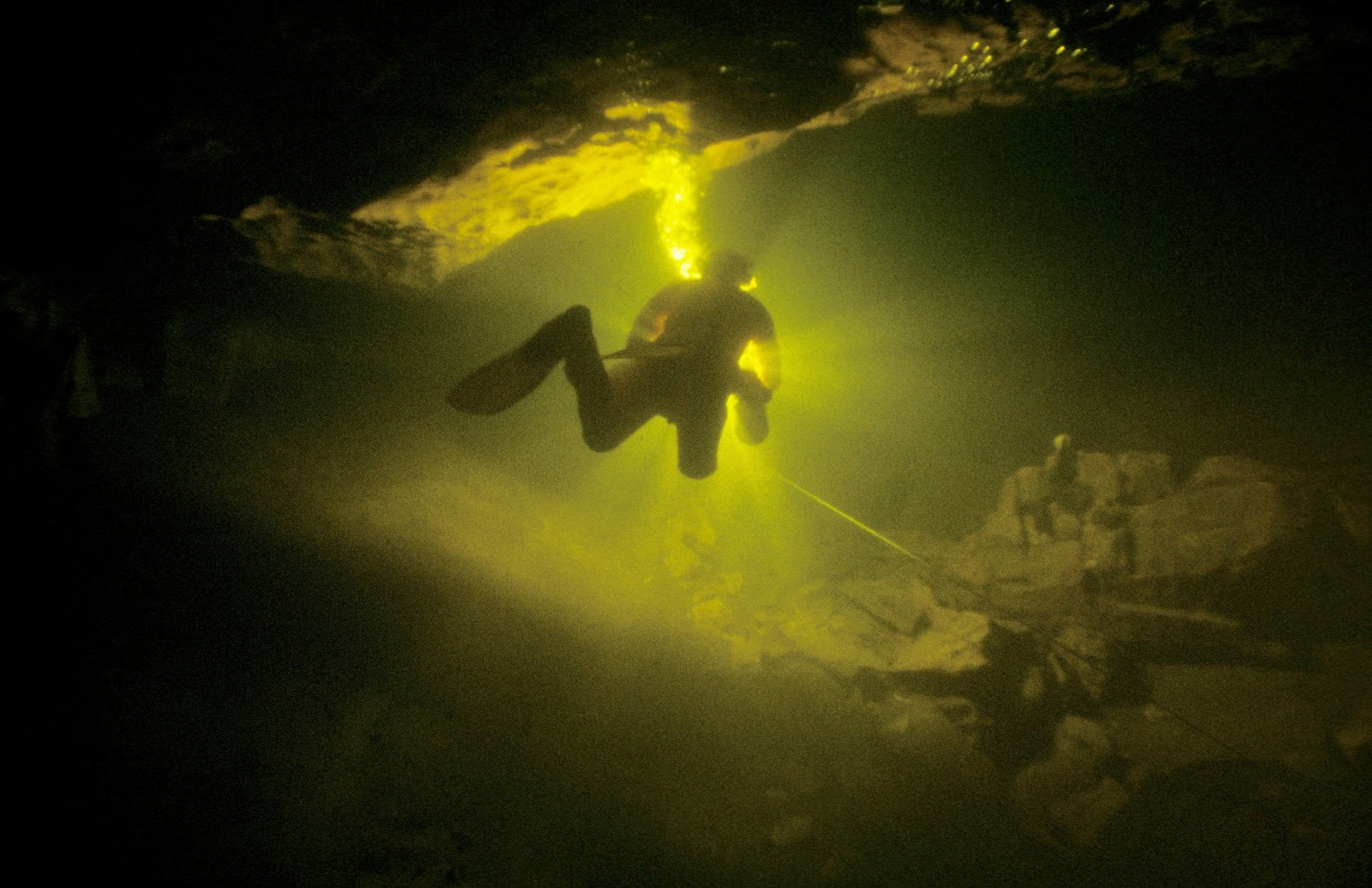 A cave diver seems to hang in space as he explores the phreatic zone between Hurtle and Jingle Pot in Chapel-le-Dale. John Cordingley