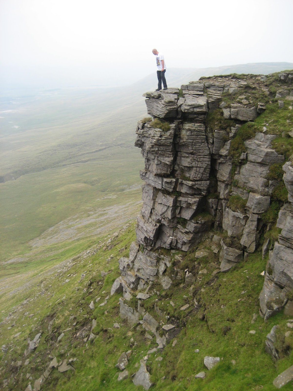 Standing on the highest sandstone ridge within the Yoredale series on Ingleborough. Stephen Oldfield